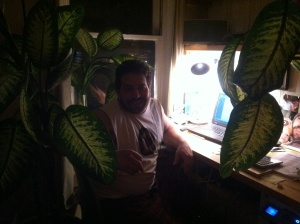 friend backlit in home office with plants
